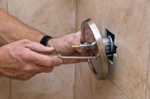 Peoria plumbing associate replaces faulty shower control